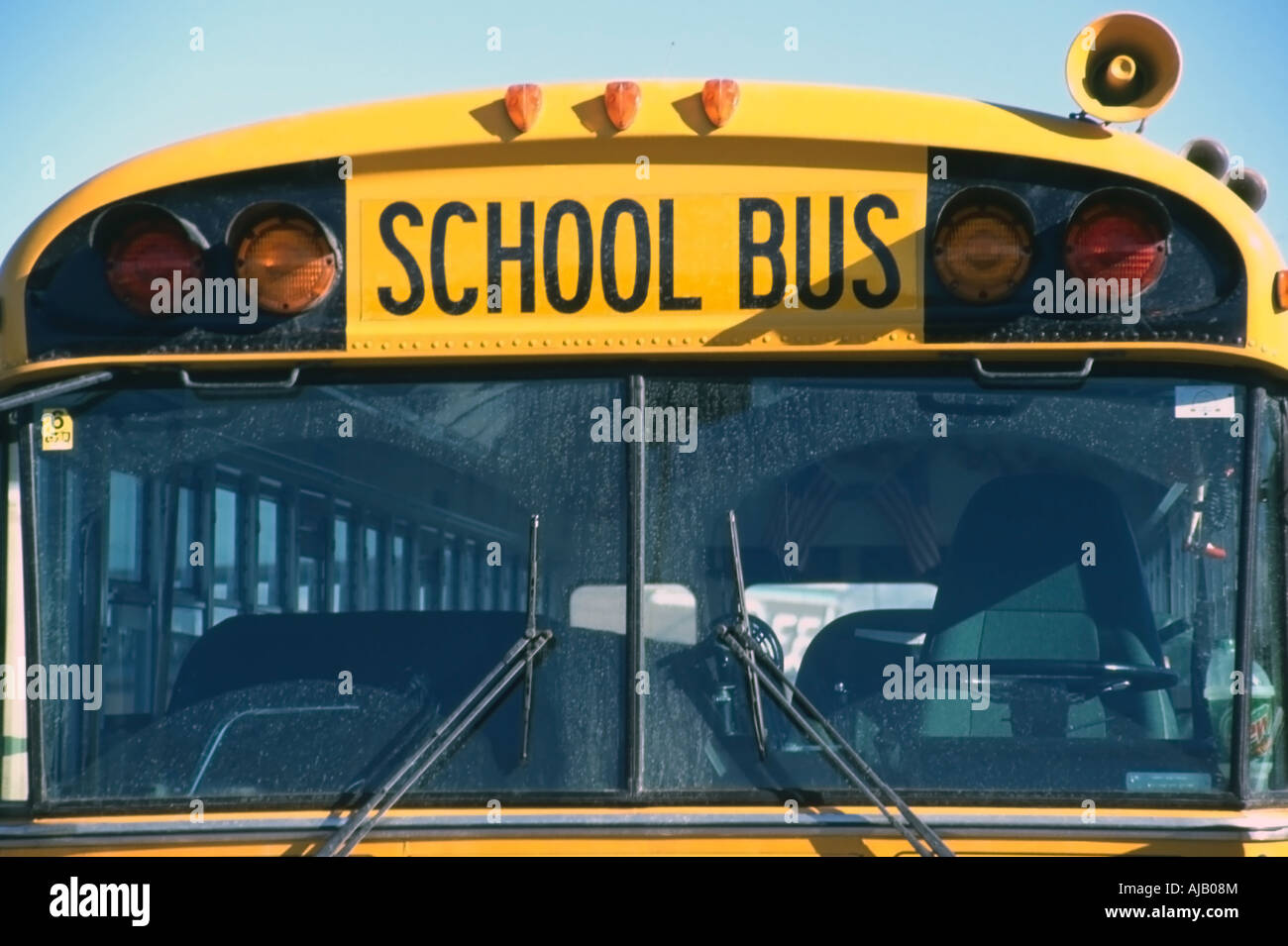 A Head On Up Close View Of A Bright Yellow School Bus Its Stock
