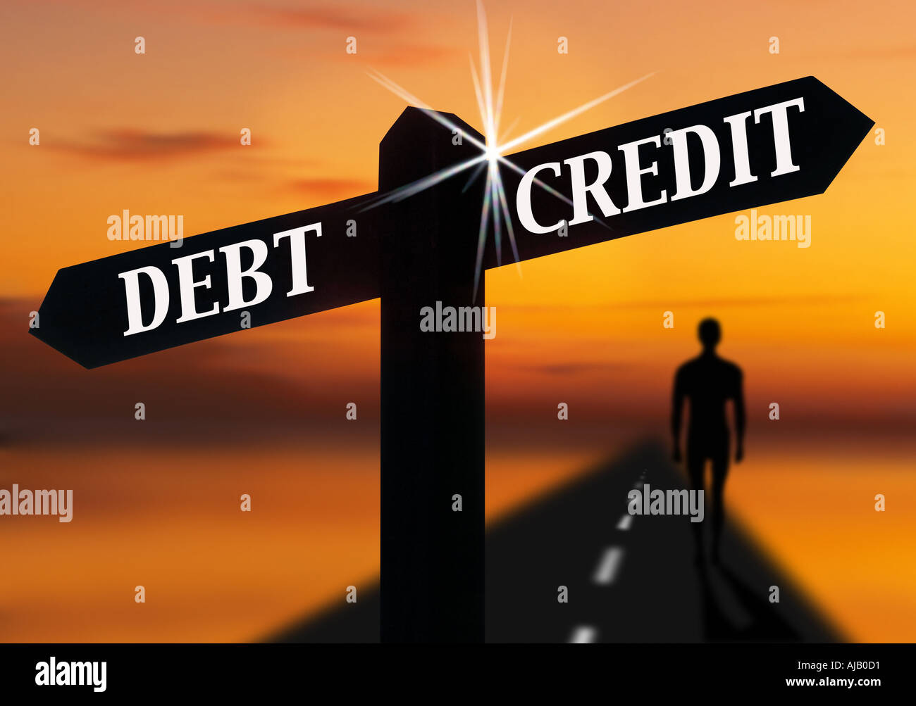 road signpost pointing to debt and credit - Stock Image