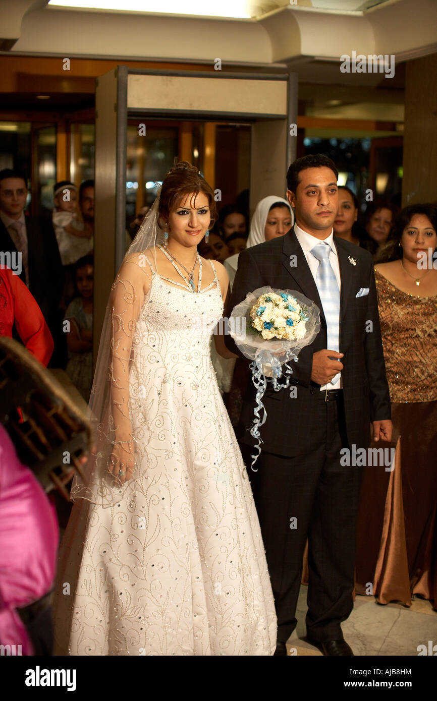Bride Groom and wedding guests at marriage ceremony party in hotel lobby Cairo Egypt Africa - Stock Image