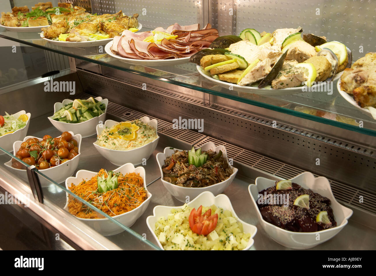 Canteen Food In Buffet With White Dishes In Stainless