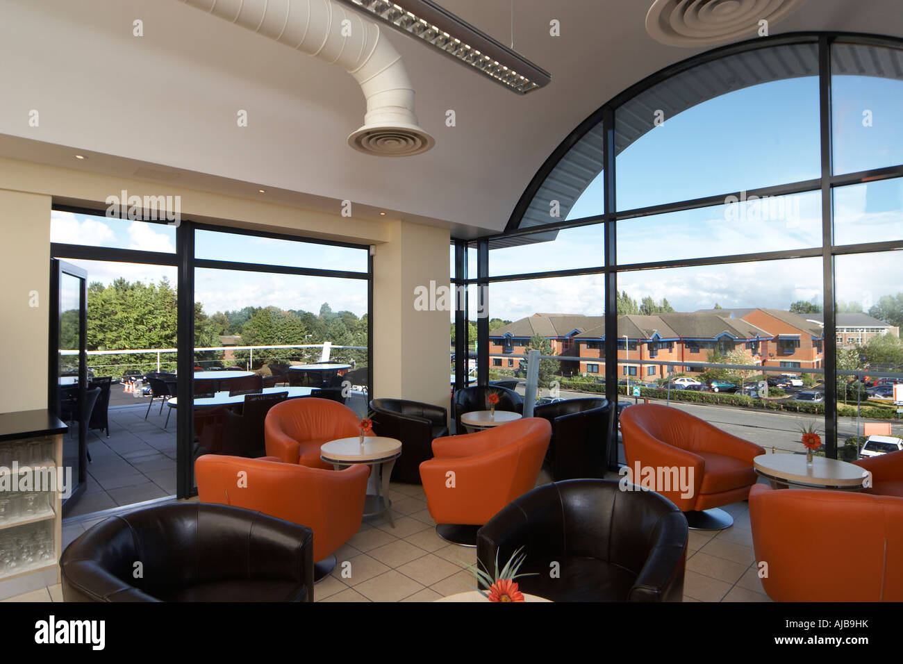 office seating area. Seating Coffee Area In Modern Office Building For Staff With Orange And Black Chairs View Through Window T