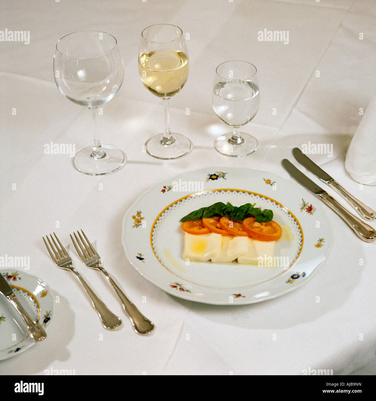 Dinner Table Setup Images: Table Setting With Silver Cutlery Laid For Dinner In