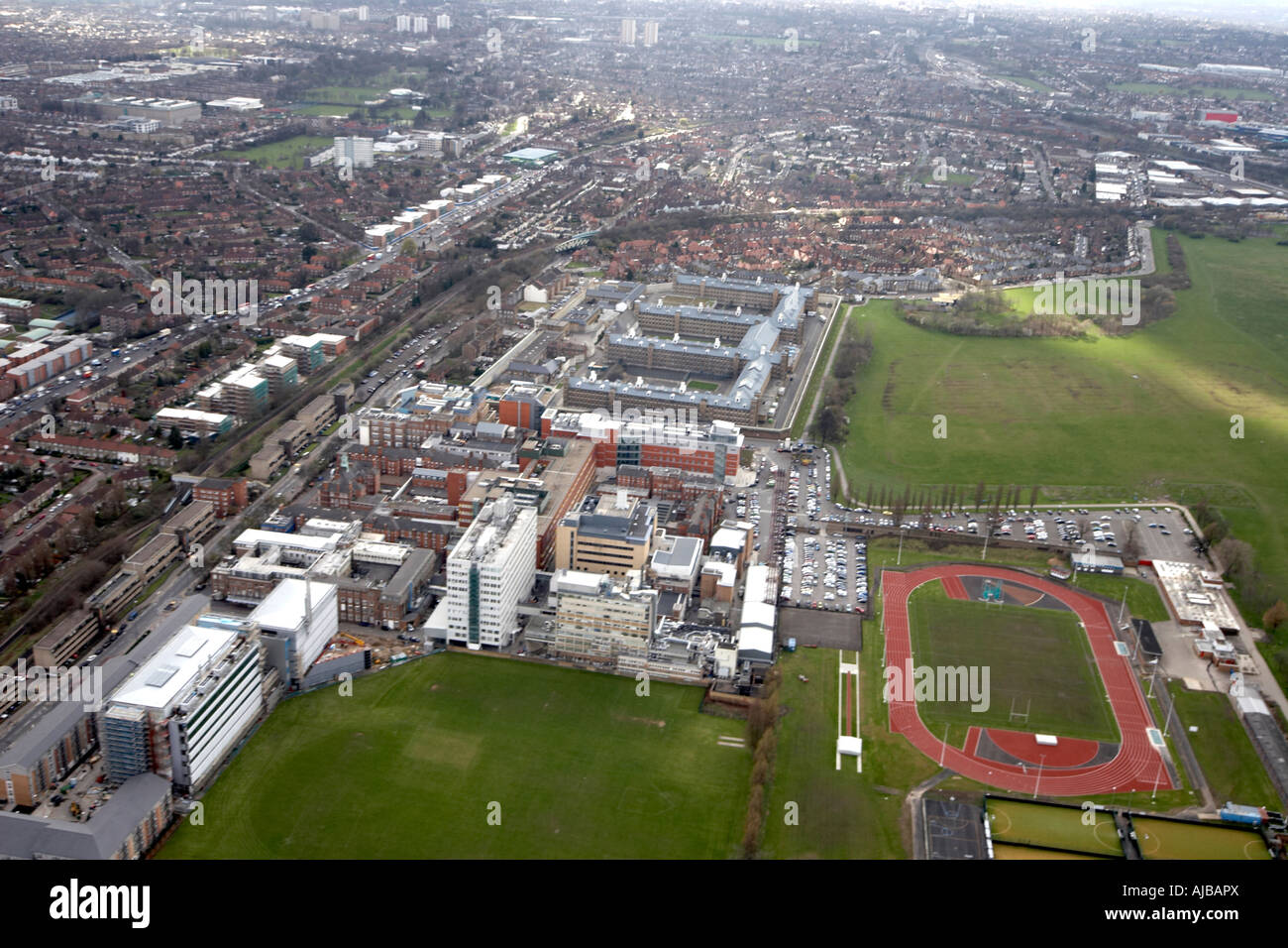 Aerial view south west of Linford Christie Stadium Hammersmith Hospital H M P Wormwood Scrubs and suburban housing - Stock Image