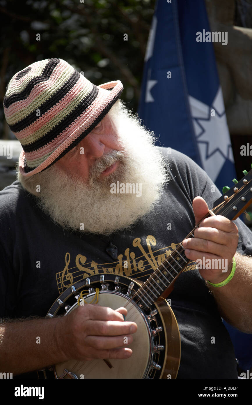 Band member with white beard and hat playing banjo at Woodford Folk Festival Queensland Australia Stock Photo