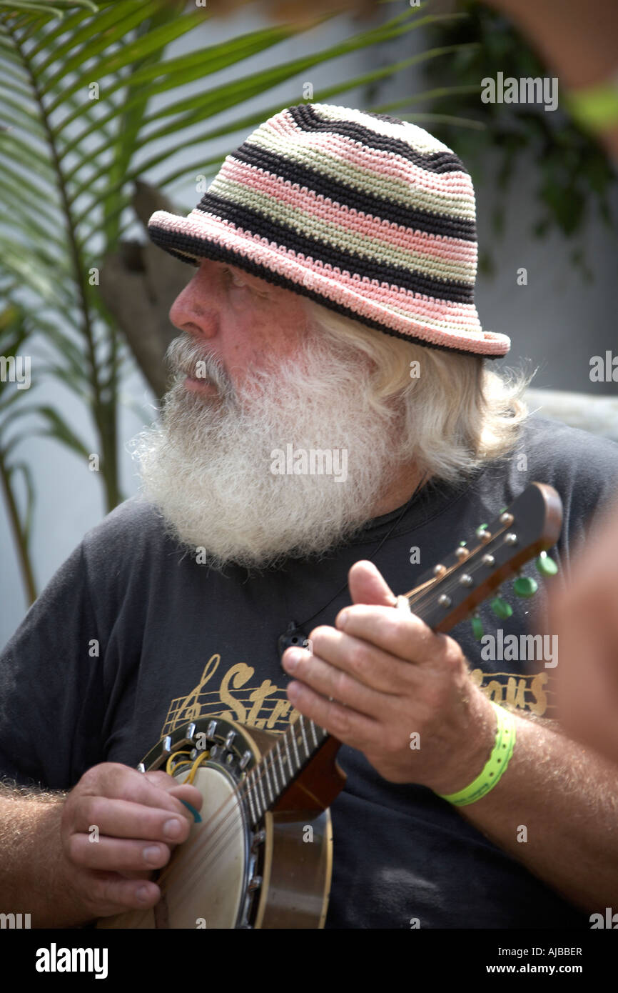 Band member with white beard and hat playing banjo at Woodford Folk Festival Queensland Australia - Stock Image