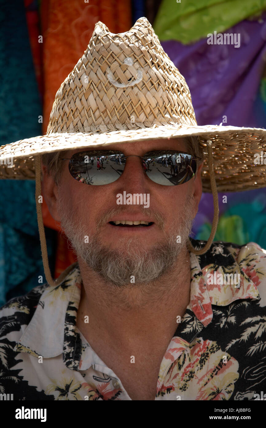 Band member with straw hat mirrored sunglasses and beard playing guitar at Woodford Folk Festival Queensland Australia - Stock Image