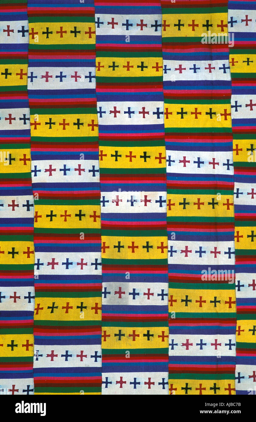 Brightly coloured woollen textile with Buddhist iconography Bhutan Stock Photo