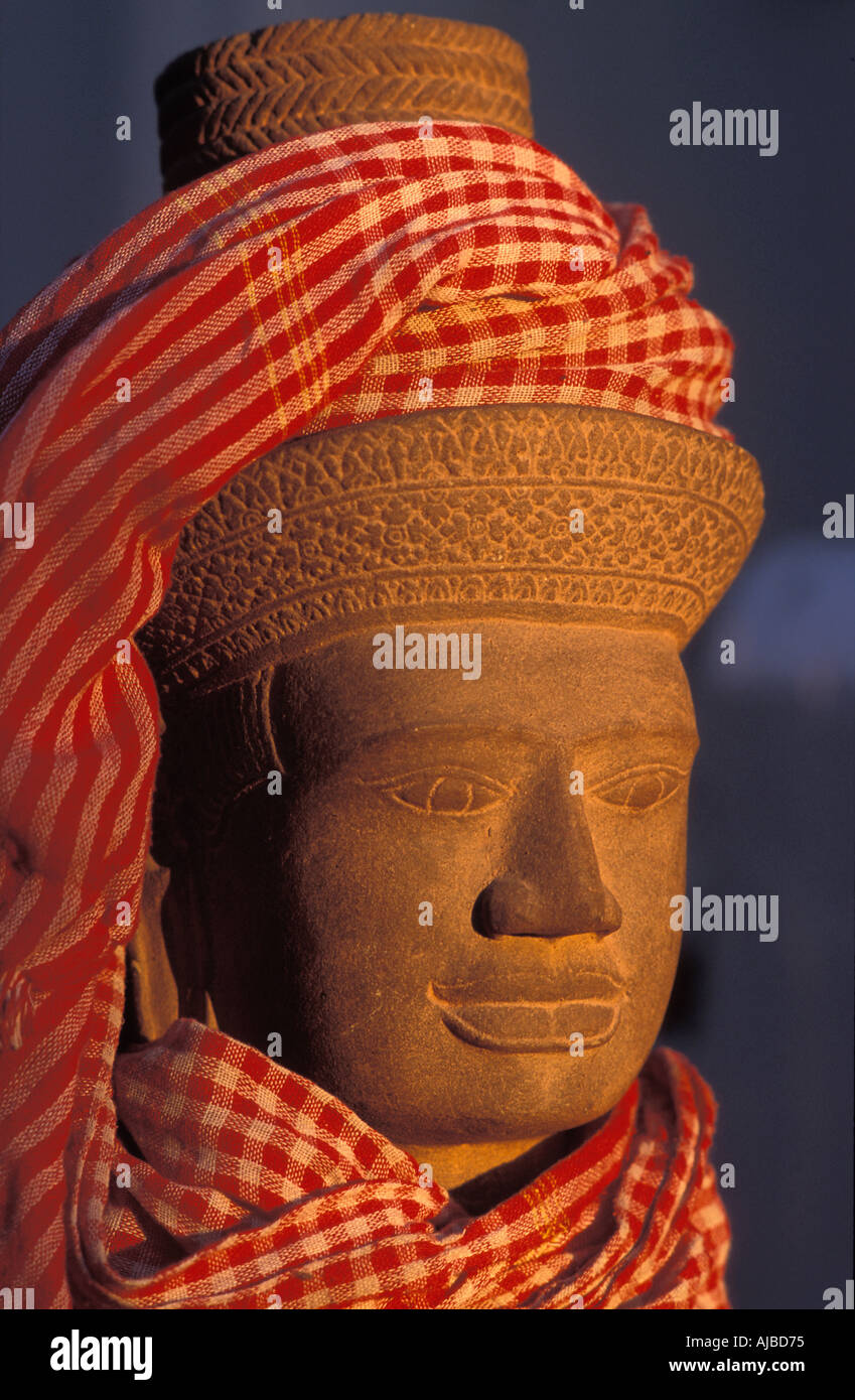 Stone sculpture Khymer style Angkor Cambodia The krama a checked cotton scarf found in local markets across the country - Stock Image