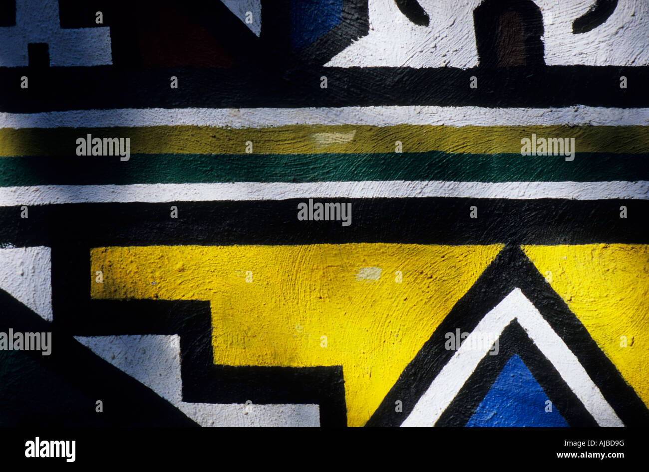 Close-up colourful painted geometric patterns on wall Traditional ...