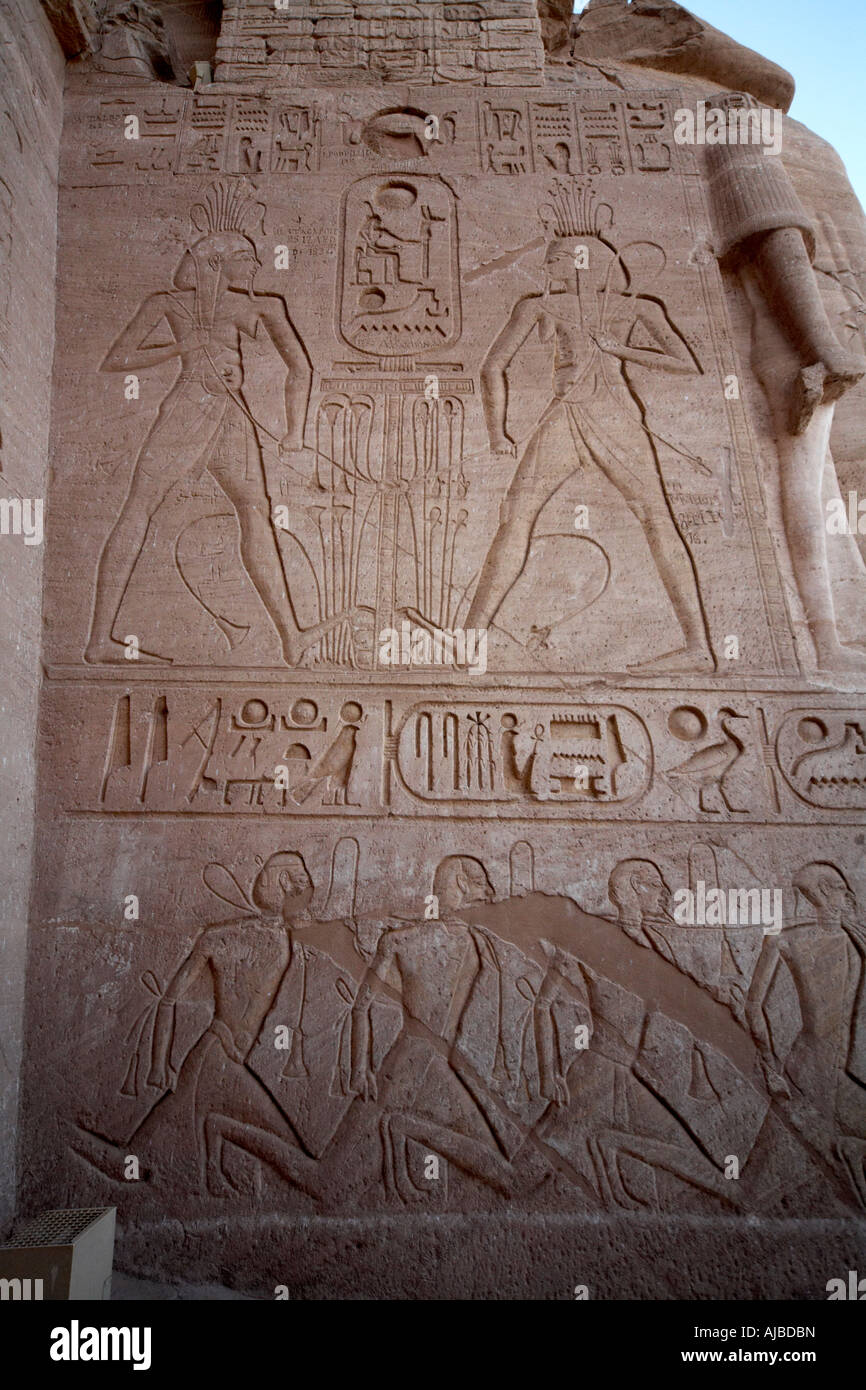 Carving of Habi Nile god tying lotus and papyrus to symbolise joining of upper and lower Egypt on Temple of Abu - Stock Image