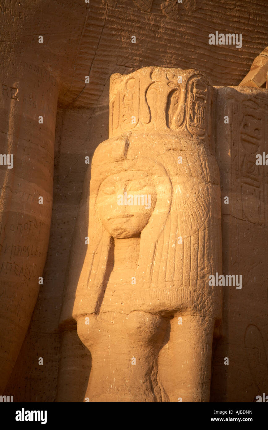 Carved statue of Hathor goddess of motherhood and music at sunrise outside the Temple of Abu Simbel Upper Egypt - Stock Image