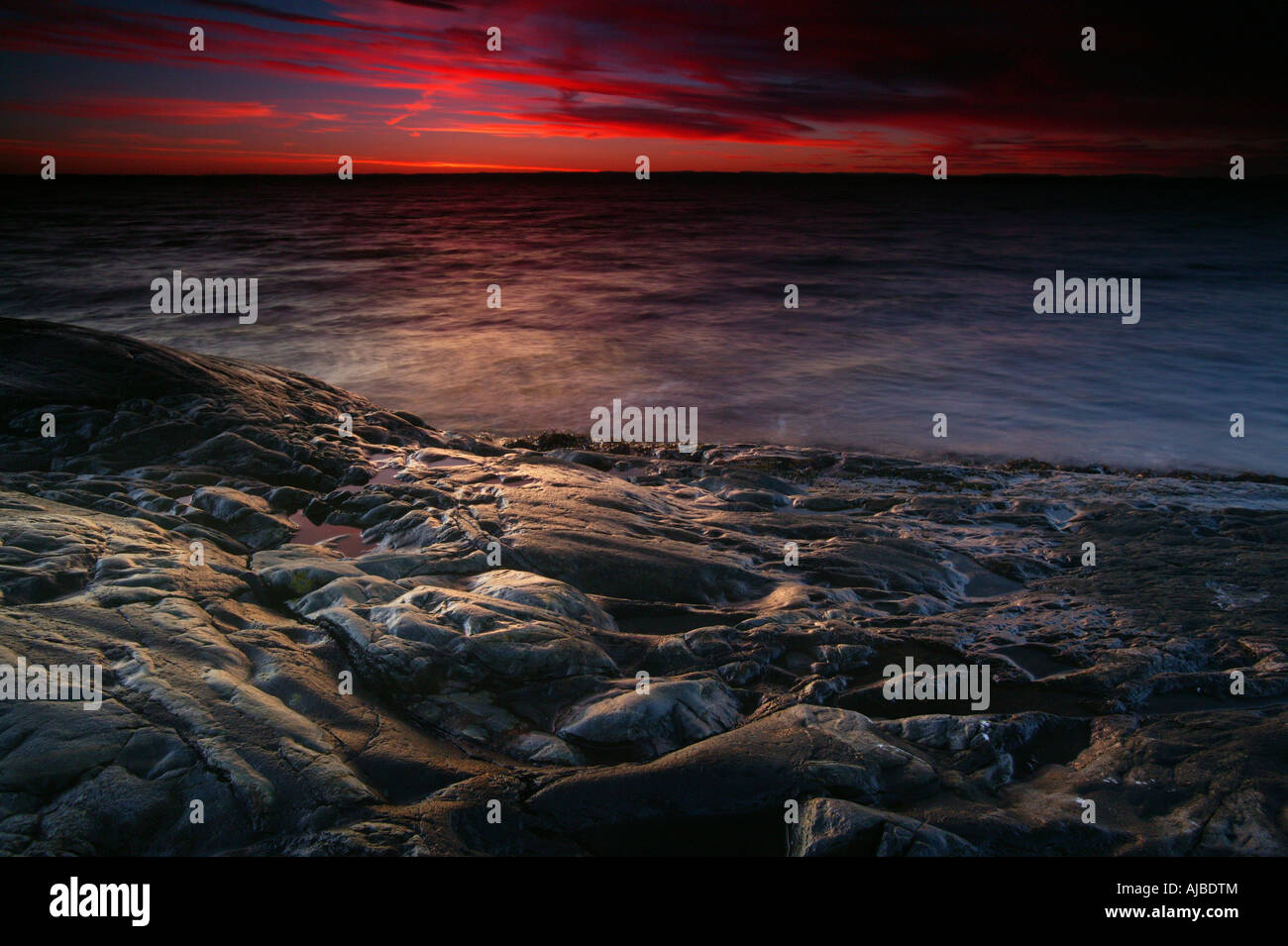 Post-sunset afterglow by the Oslofjord at Larkollen in Rygge kommune, Østfold fylke, Norway. - Stock Image