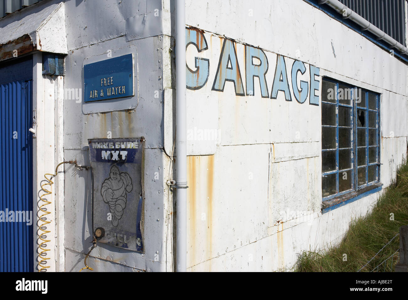 From a bygone era architectural details of a white painted garage exterior in Dunvegan Isle of Skye Scotland - Stock Image