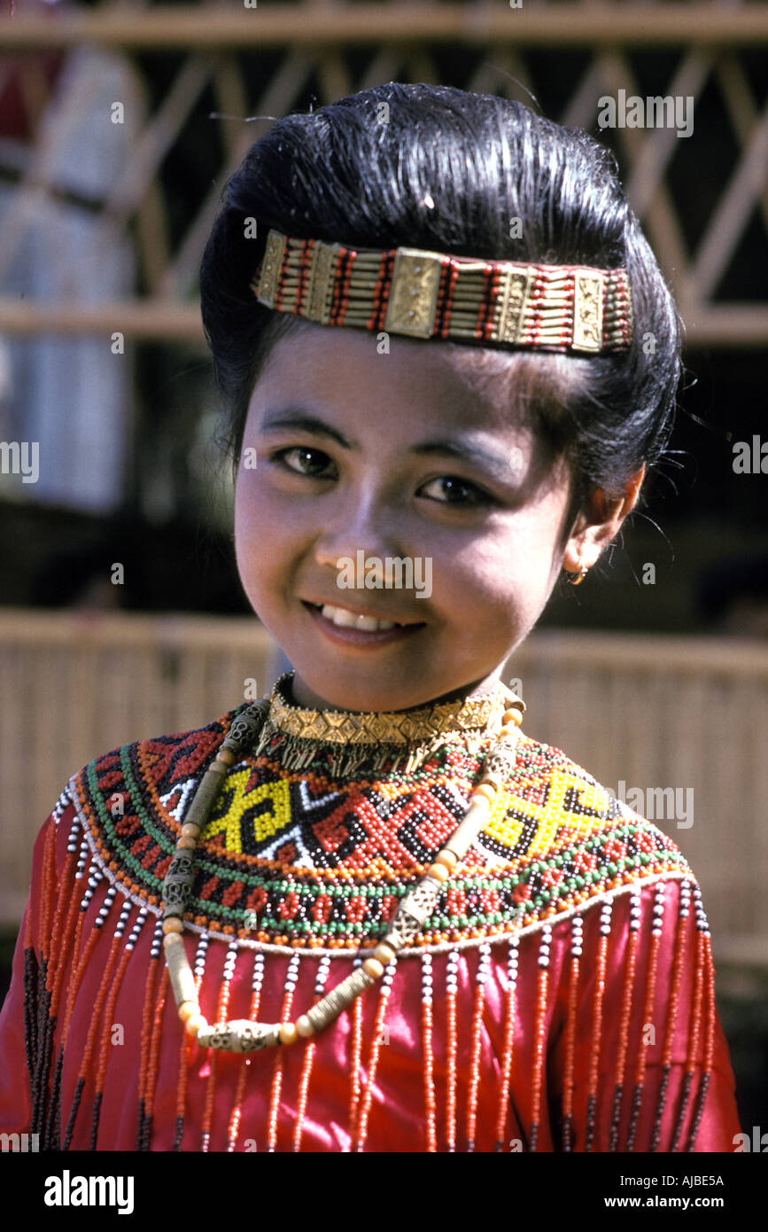 Tana Toraja Toraja girl with beadwork encrusted costume at a family ceremony to mark a wedding Sulawesi - Stock Image