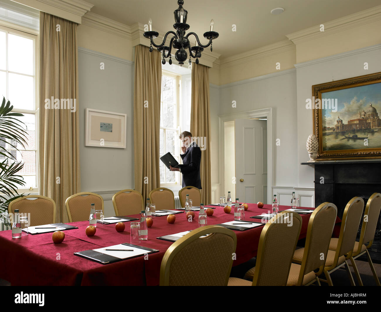 Boardroom set for a meeting to begin - Stock Image