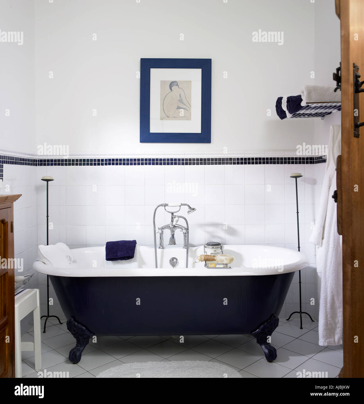 Bathroom with blue bath - Stock Image