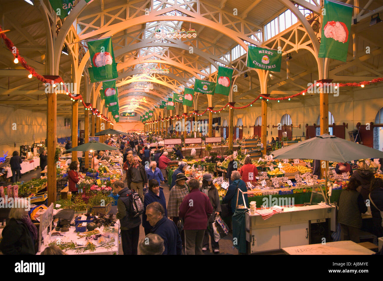 indoor pannier market with ornate arched roof lit up with christmas decorations in barnstaple north devon england