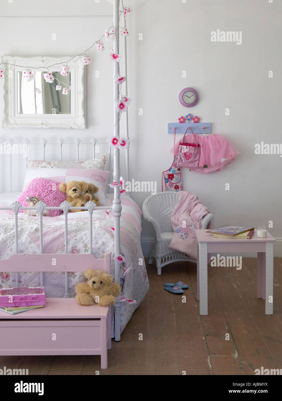 A Pink Girls Bedroom with Side Table and Mirror Stock Photo ...