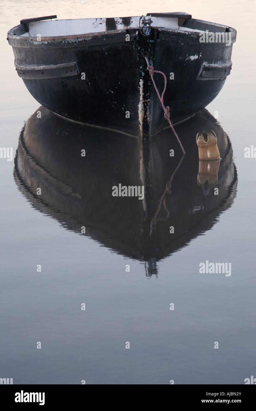 Lone Row Boat Anchored in the Knysna Lagoon - Stock Image