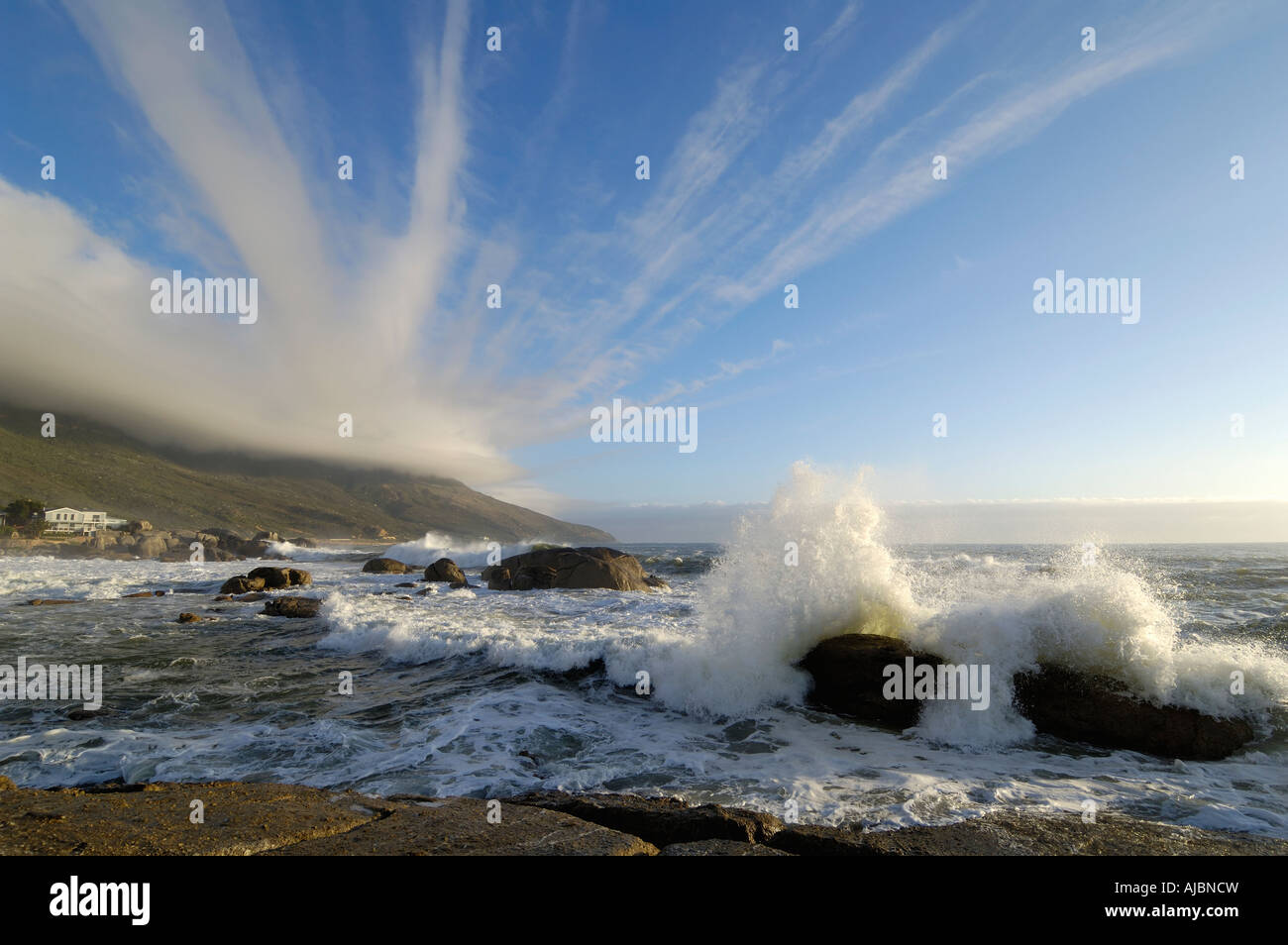 Strange Cloud Formations Emanate from the Table Cloth on the Twelve Apostles over the Bakoven Shoreline - Stock Image