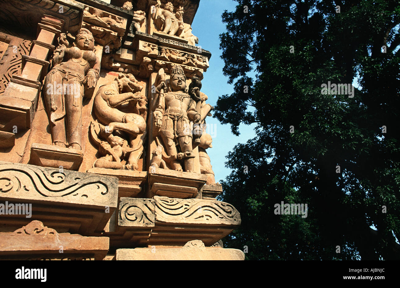 The ancient site of Khajuraho is reknowned for the intricate stone masonry depicted on it s temple walls Madhya Pradseh India - Stock Image