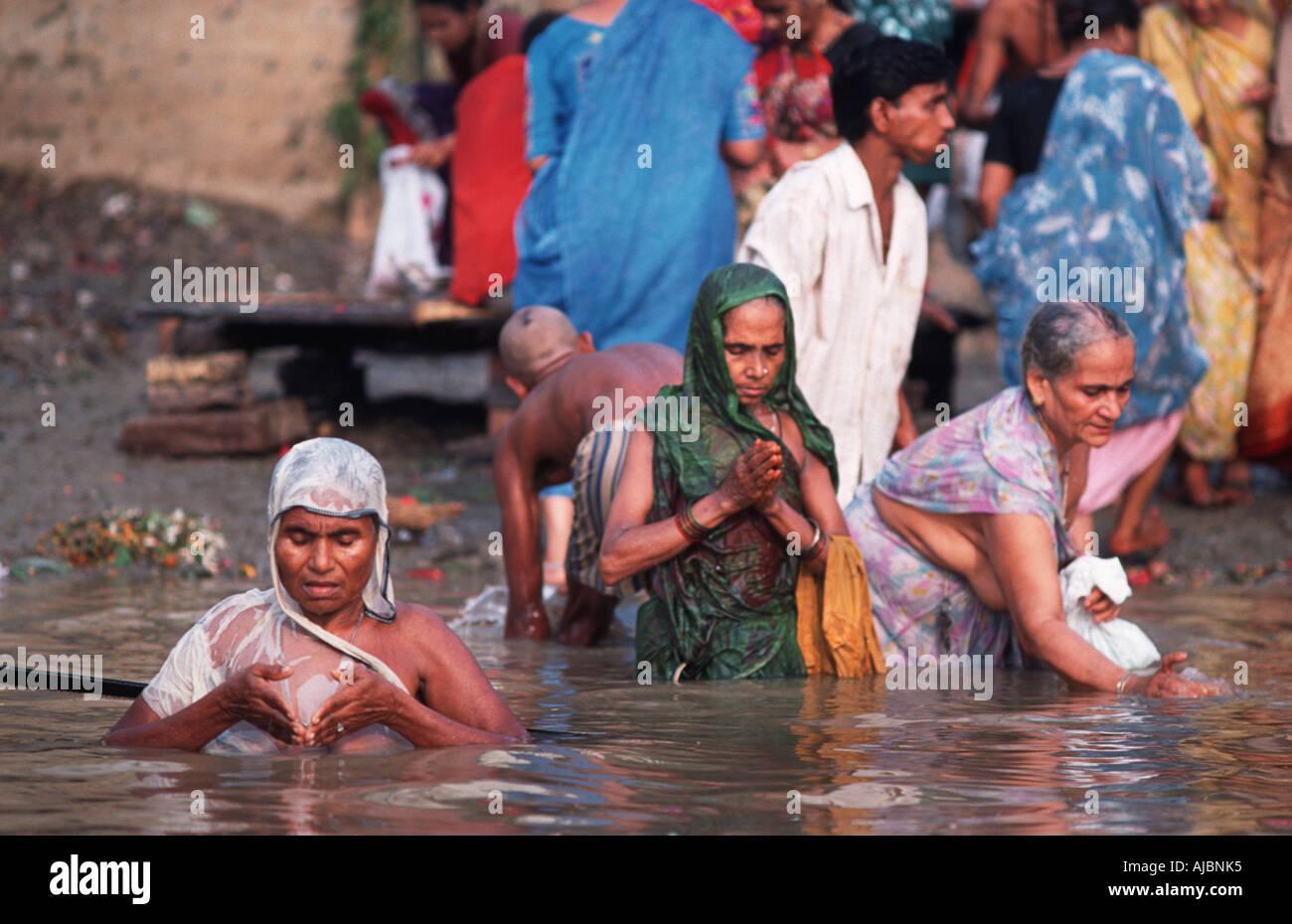 Indian women undertaking ritual bathing in the Ganges at Varanasi India - Stock Image