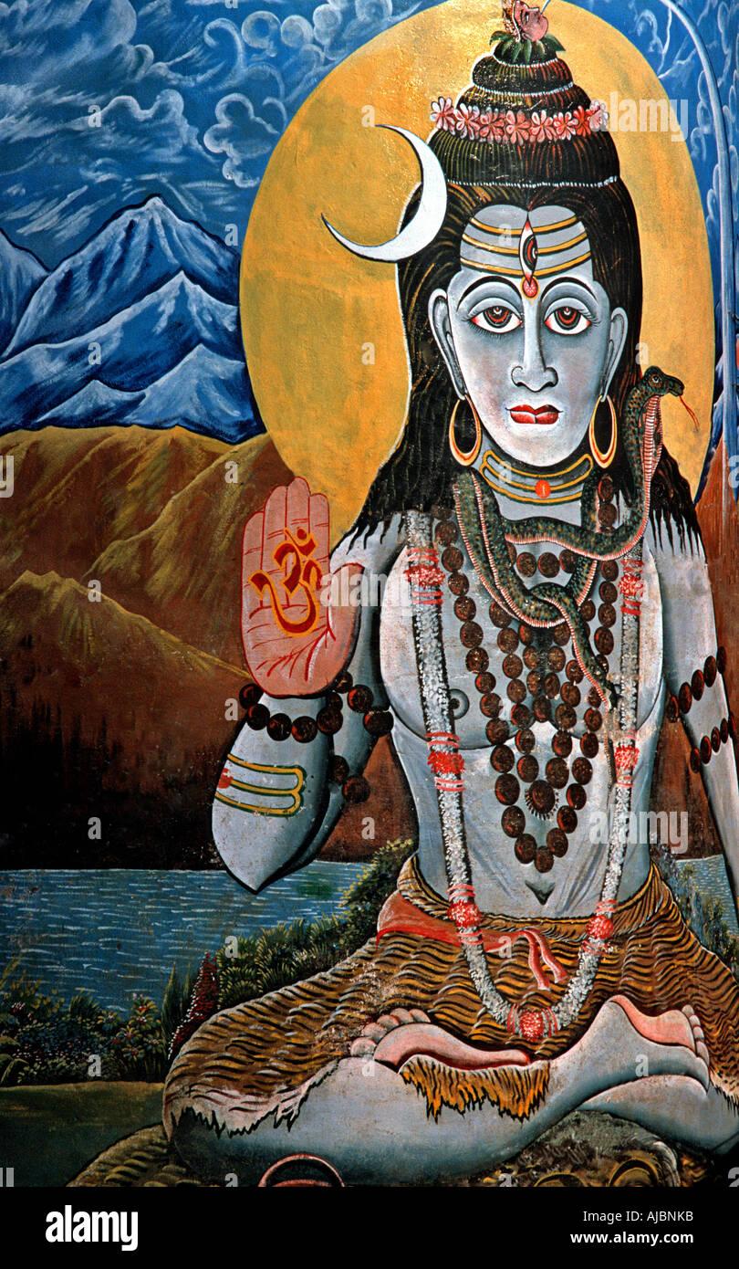 Painting on a wall beside a ghat at Varanasi India depicting Krishna - Stock Image