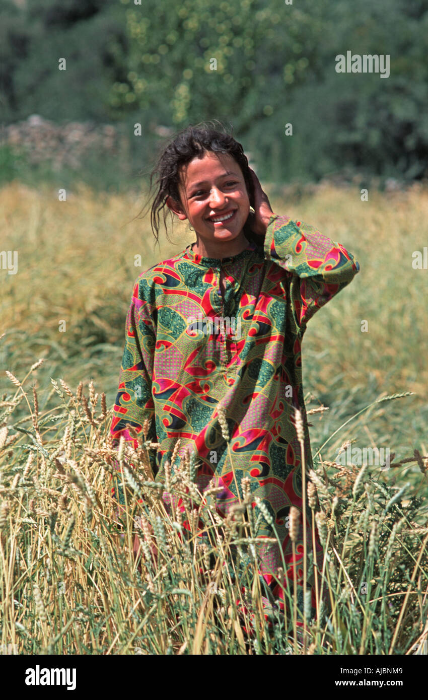 Young Pakistani woman in her fields of barley Sust near the Chinese border Northern Pakistan Stock Photo