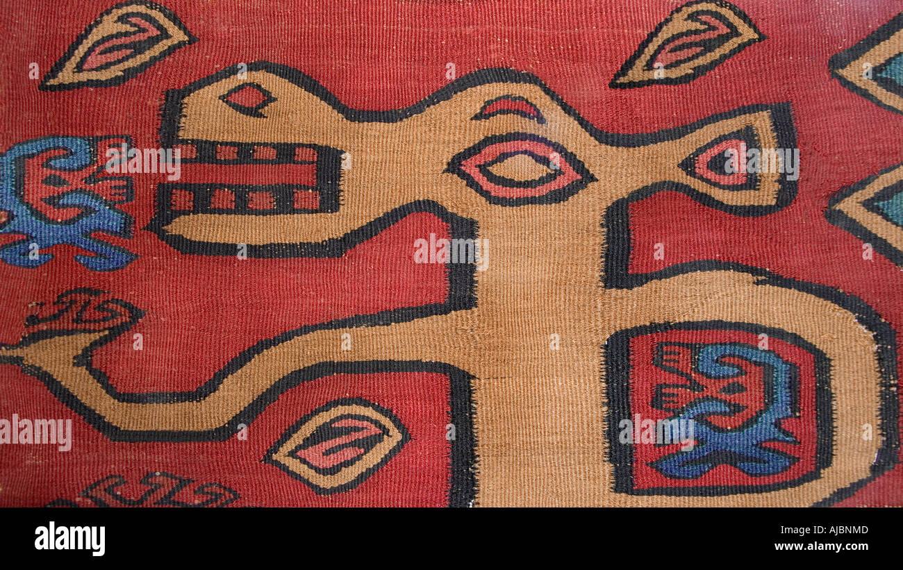 Ancient preColumbian tapestry fragment from Peru Zoomorphic motif South America - Stock Image