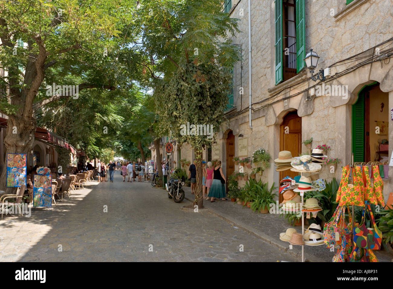 Shops on the main street in the centre of the old town, Valldemossa, West Coast, Mallorca, Spain - Stock Image
