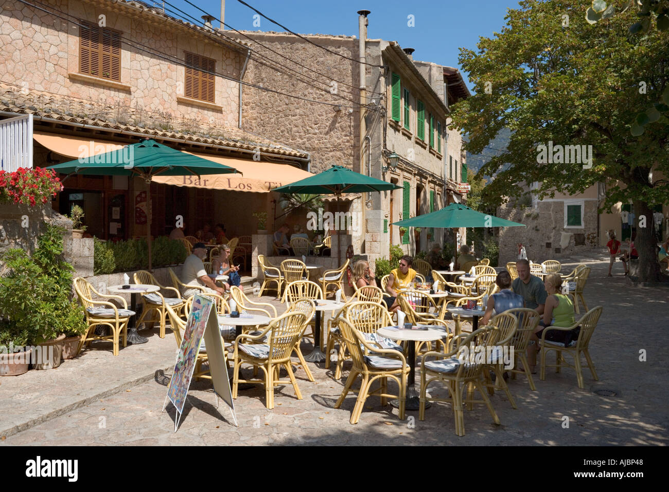 Cafe in the Placa de Cartoixa, Old Town of Valldemossa, West Coast, Mallorca, Spain - Stock Image