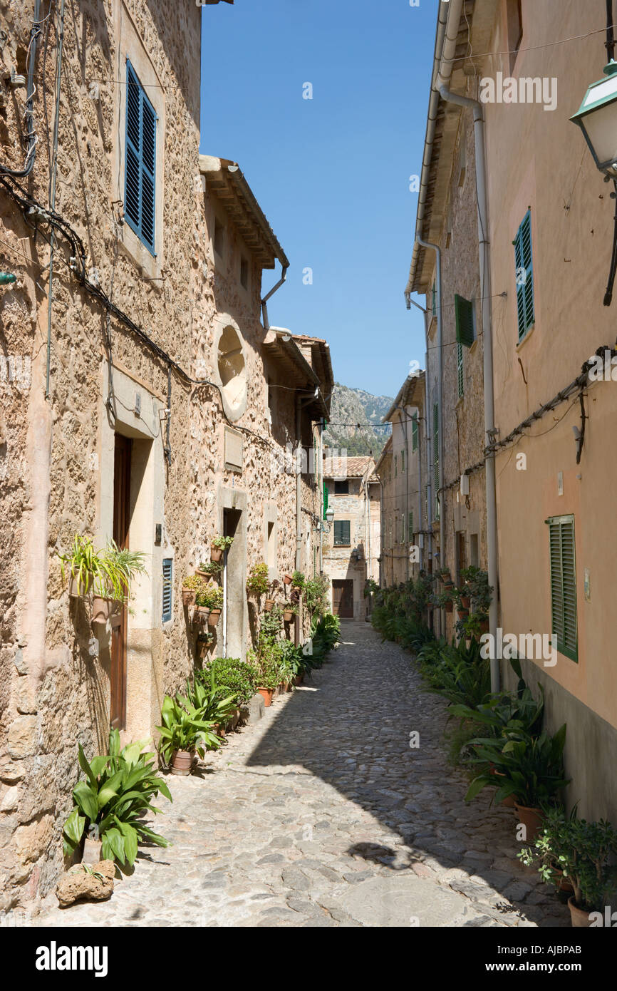 Narrow Cobbled Street in the Old Town of Valldemossa, West Coast, Mallorca, Spain Stock Photo