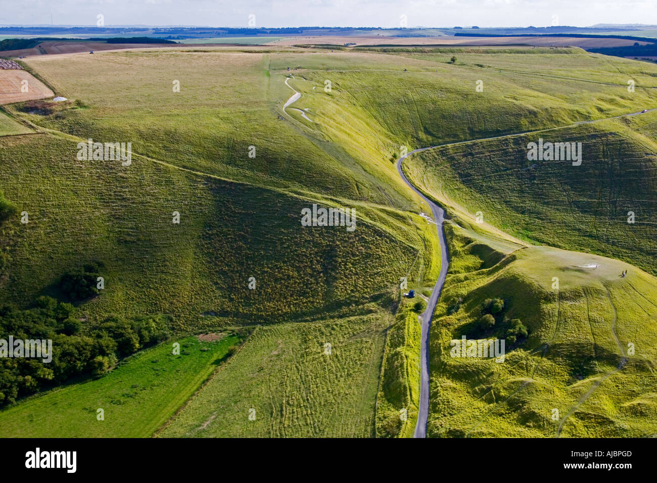 The ancient White Horse chalk figure and Dragon Hill near Uffington Oxfordshire England from the air JMH1710 Stock Photo