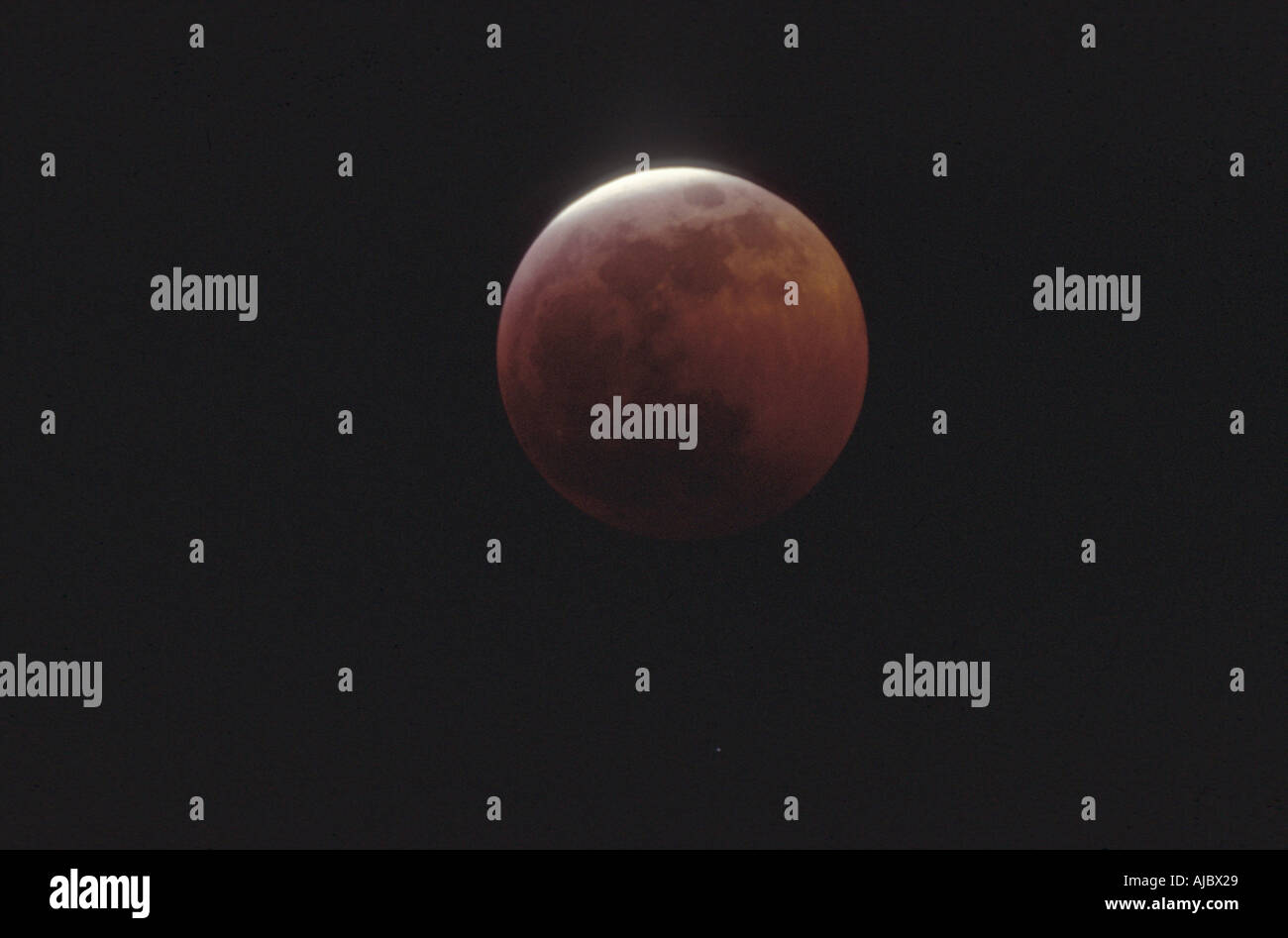 total lunar eclipse, with red shining moon - Stock Image