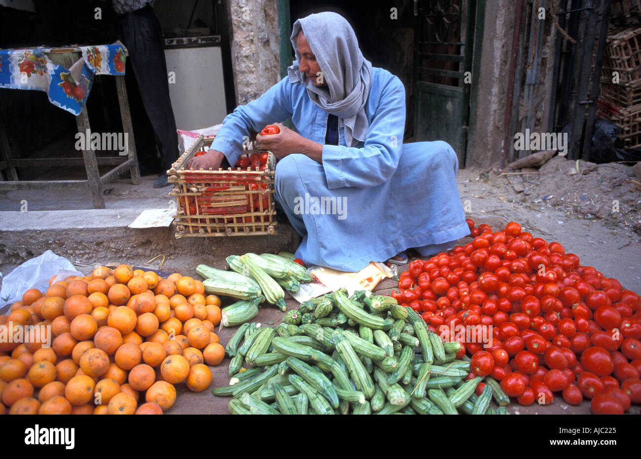 Fruit and vegetable vendor at his stall Luxor s street market Egypt Stock Photo