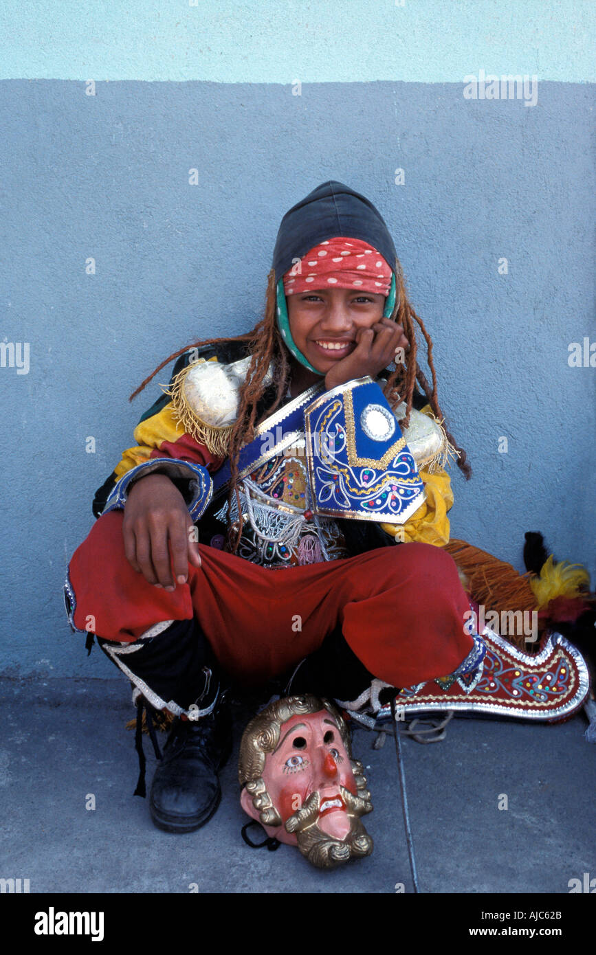 Young un masked dancer taking a break from performing the dance of the Moors Cuyotenango Guatemala - Stock Image