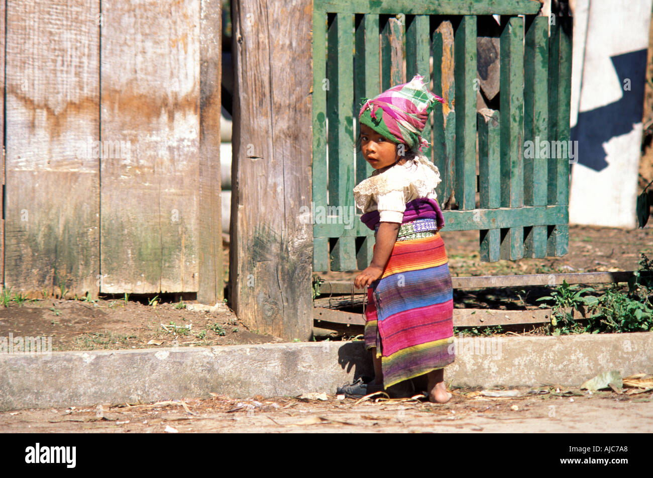 Young girl in the distinctive dress of her tribal group K iche Maya Guatemalan highland market Guatemala - Stock Image