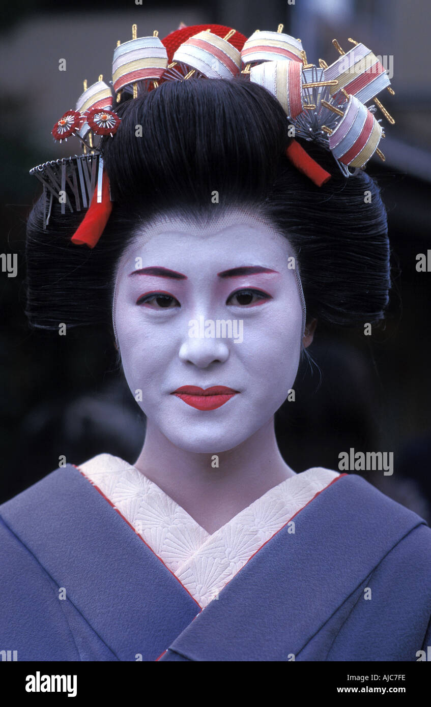 Portrait of a young woman dressed up as a Maiko in kimono and obo Kyoto Japan Geisha - Stock Image