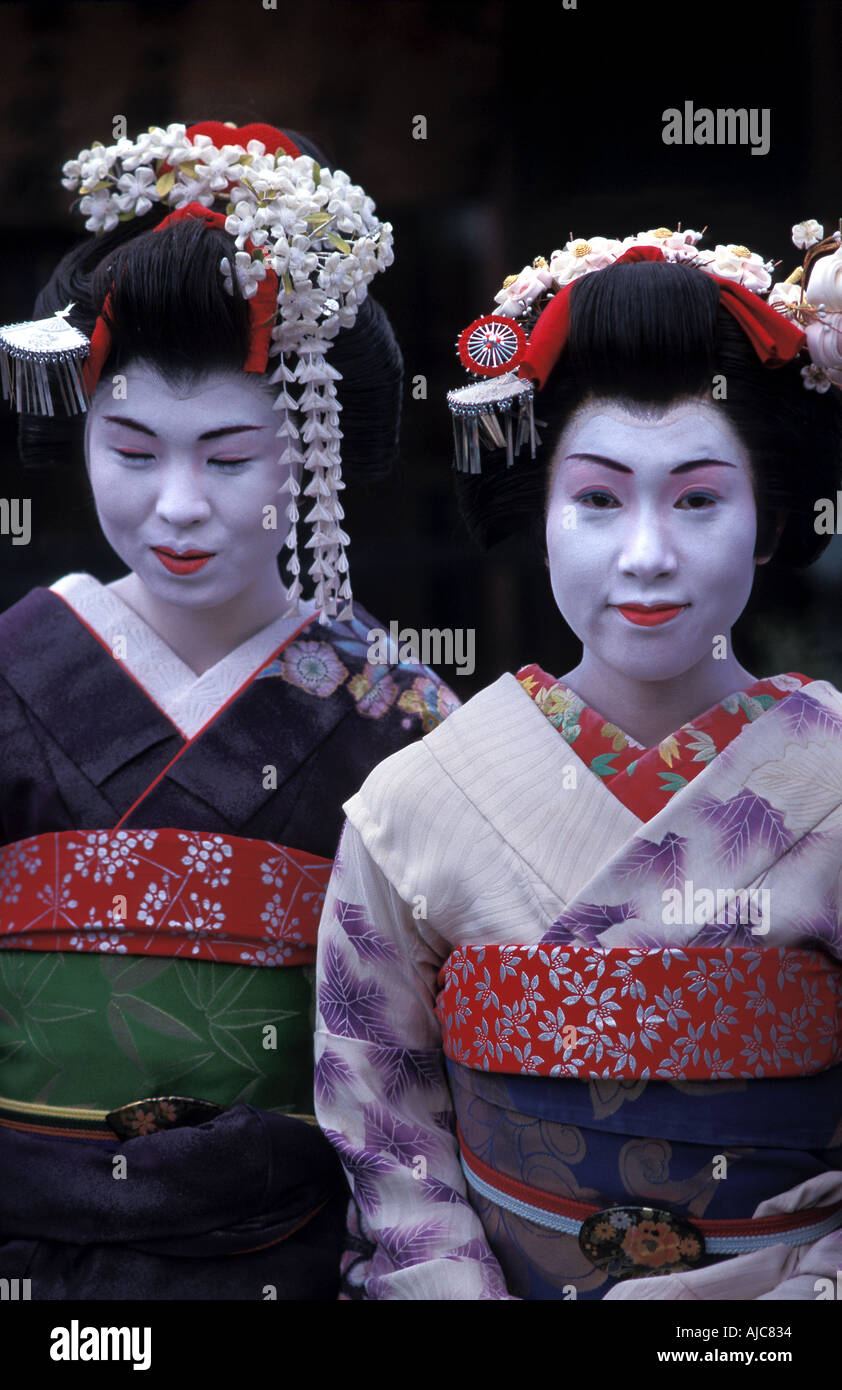 Young women dressed up as Maikos in kimonos and obos Kyoto Japan Geisha - Stock Image