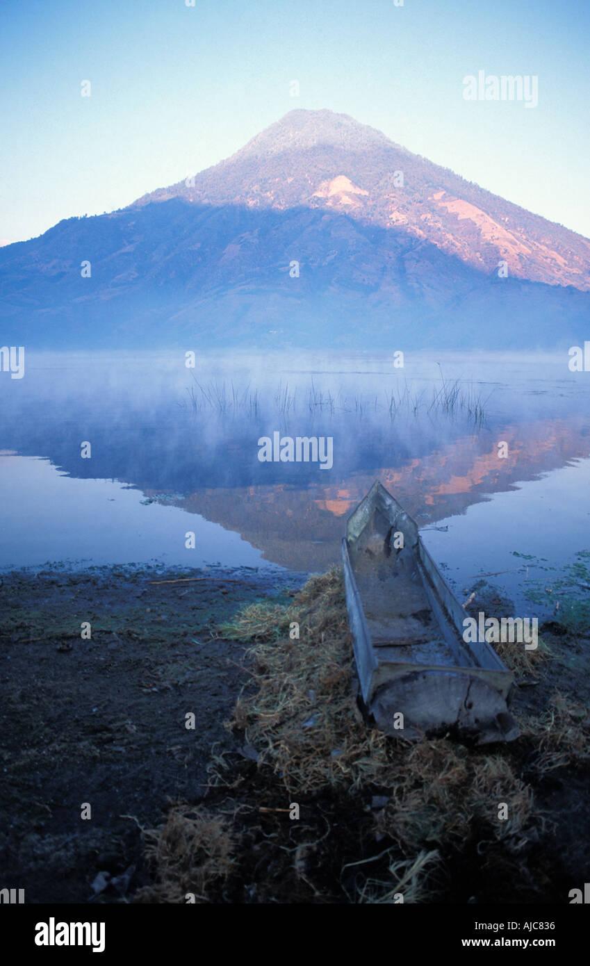 Canoe at dawn Santiago Atitlan a Tzutuhil Maya community Lake Atitlan Guatemala San Pedro volcano - Stock Image