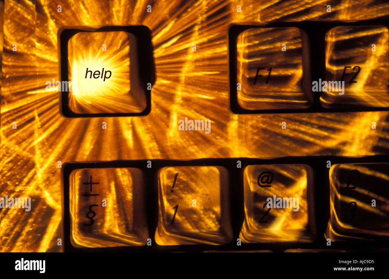 A sunburst focused on the help key of a keyboard 'digitally enhanced' image help inserted onto key - Stock Image