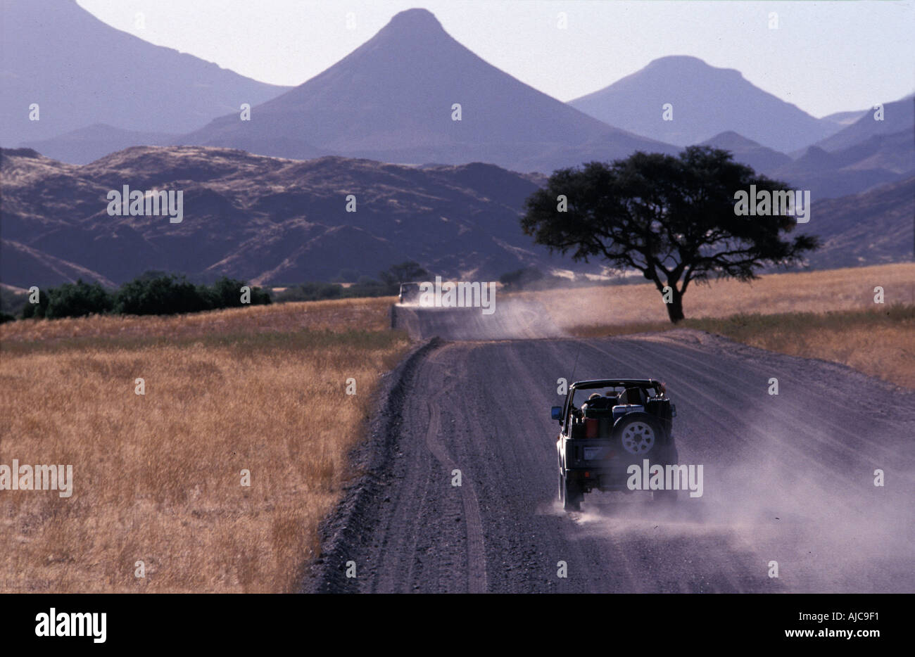 Cruising on gravel roads Palmwag to Sesfontein Extinct volcanoes and tabletop mountains line the horizon Namibia - Stock Image