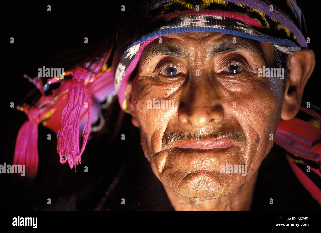 Religious Maya elder wearing a woven headcloh symbol of his authority Santiago Atitlan Guatemala - Stock Image