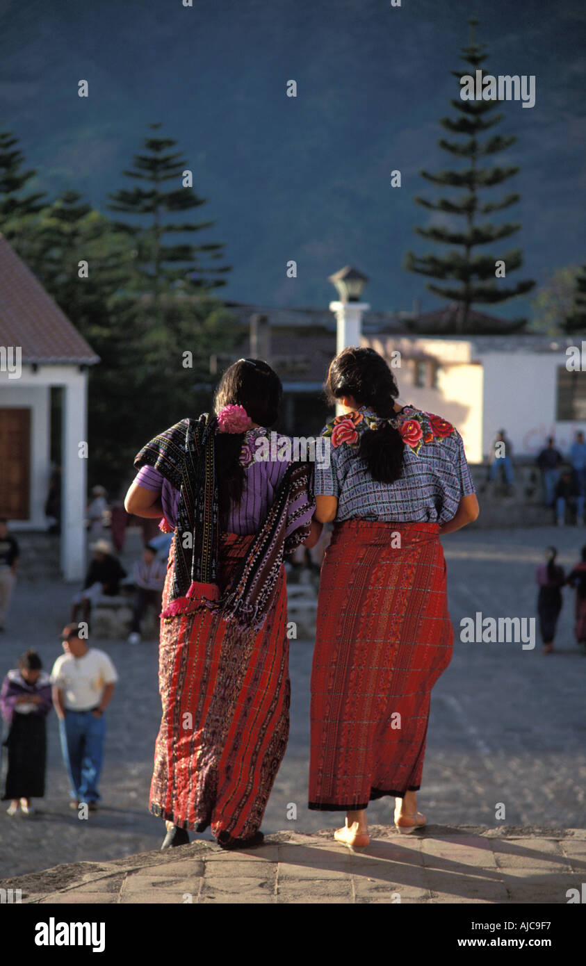 Maya women from Santiago Atitlan leaving church Bright skirts and sumptuosly decorated blouses huipiles Guatemala - Stock Image
