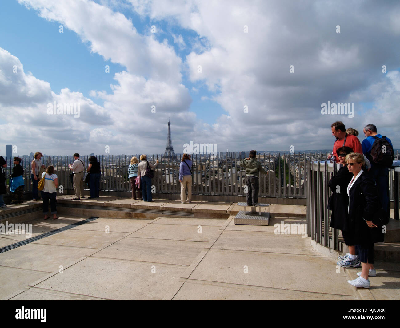 The observation deck on top of the Arc de Triomphe with many tourists looking at the Eiffel tower Paris France - Stock Image
