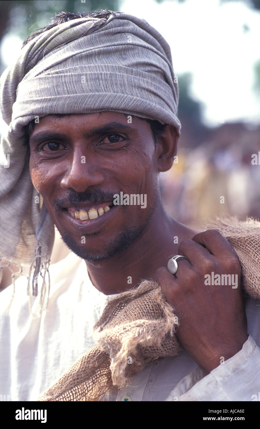 Portrait of a friendly man at Agra s early morning vegetable market India - Stock Image