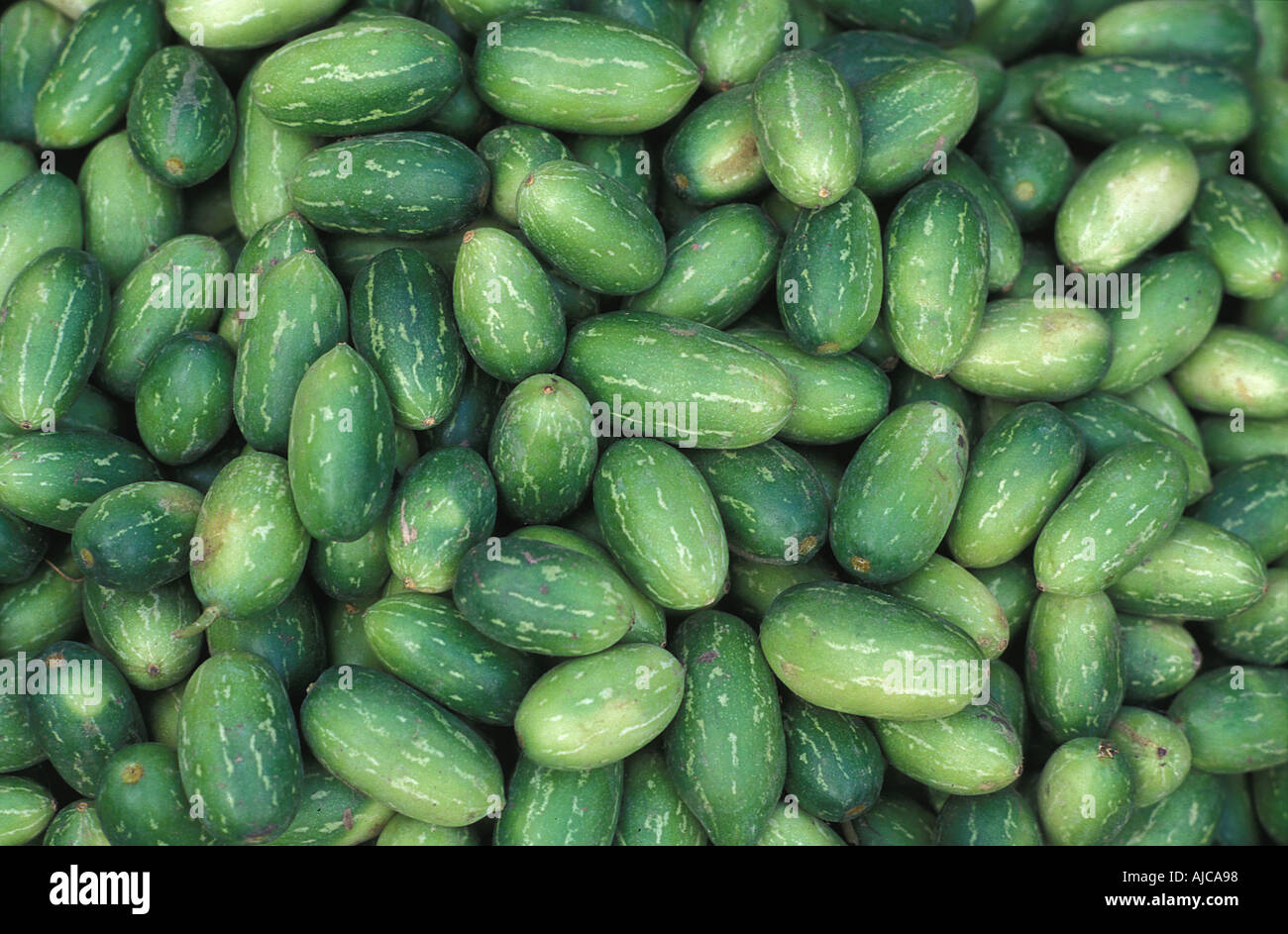 Fruit and vegetable stalls at market Varanasi India - Stock Image