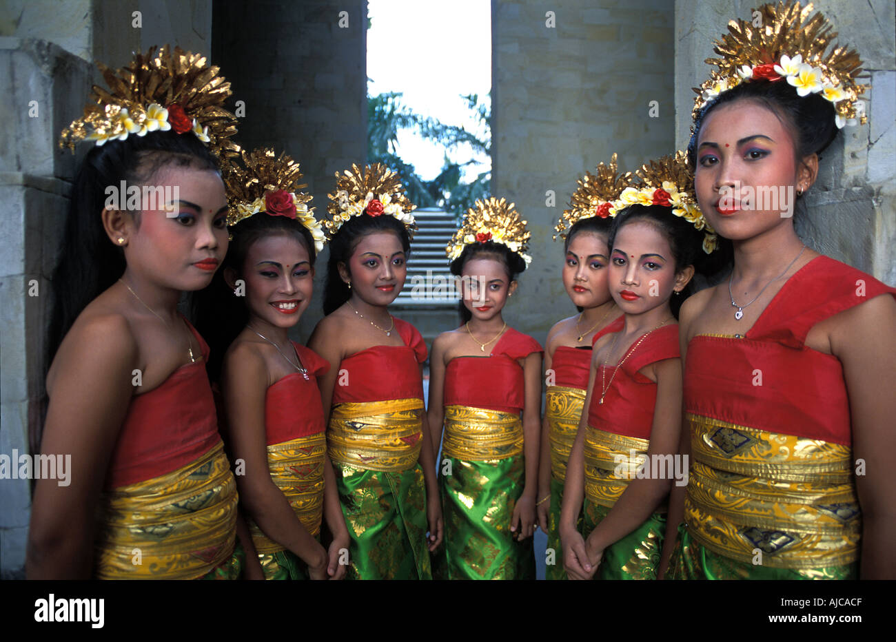 A group of young brightly dressed Balinese dancers Getting ready to perform Ubud Indonesia - Stock Image