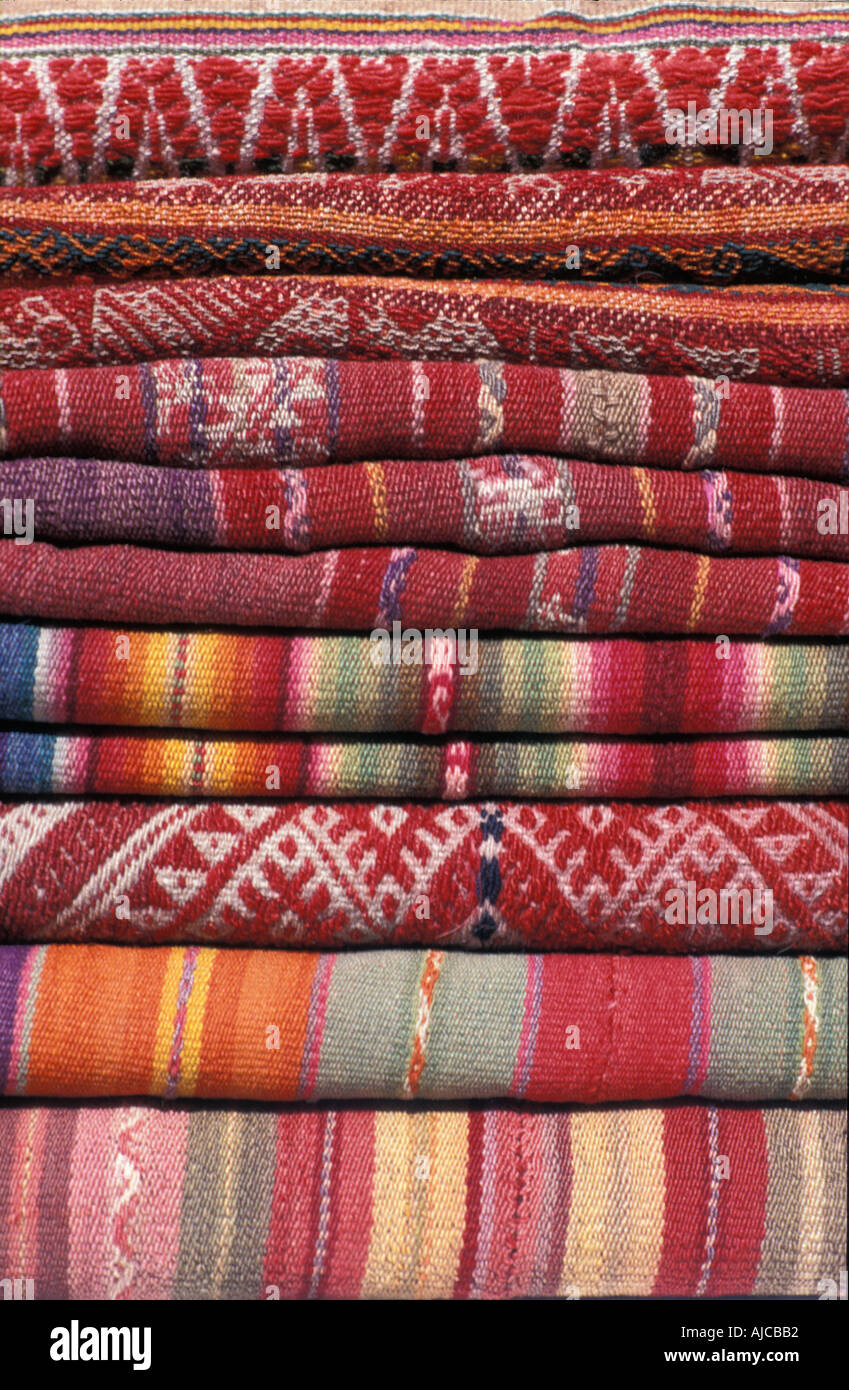 Stack of Andean fabrics from Peru and Bolivia As sold in the markets of La Paz Bolivia and Cuzco and Pisac Peru - Stock Image