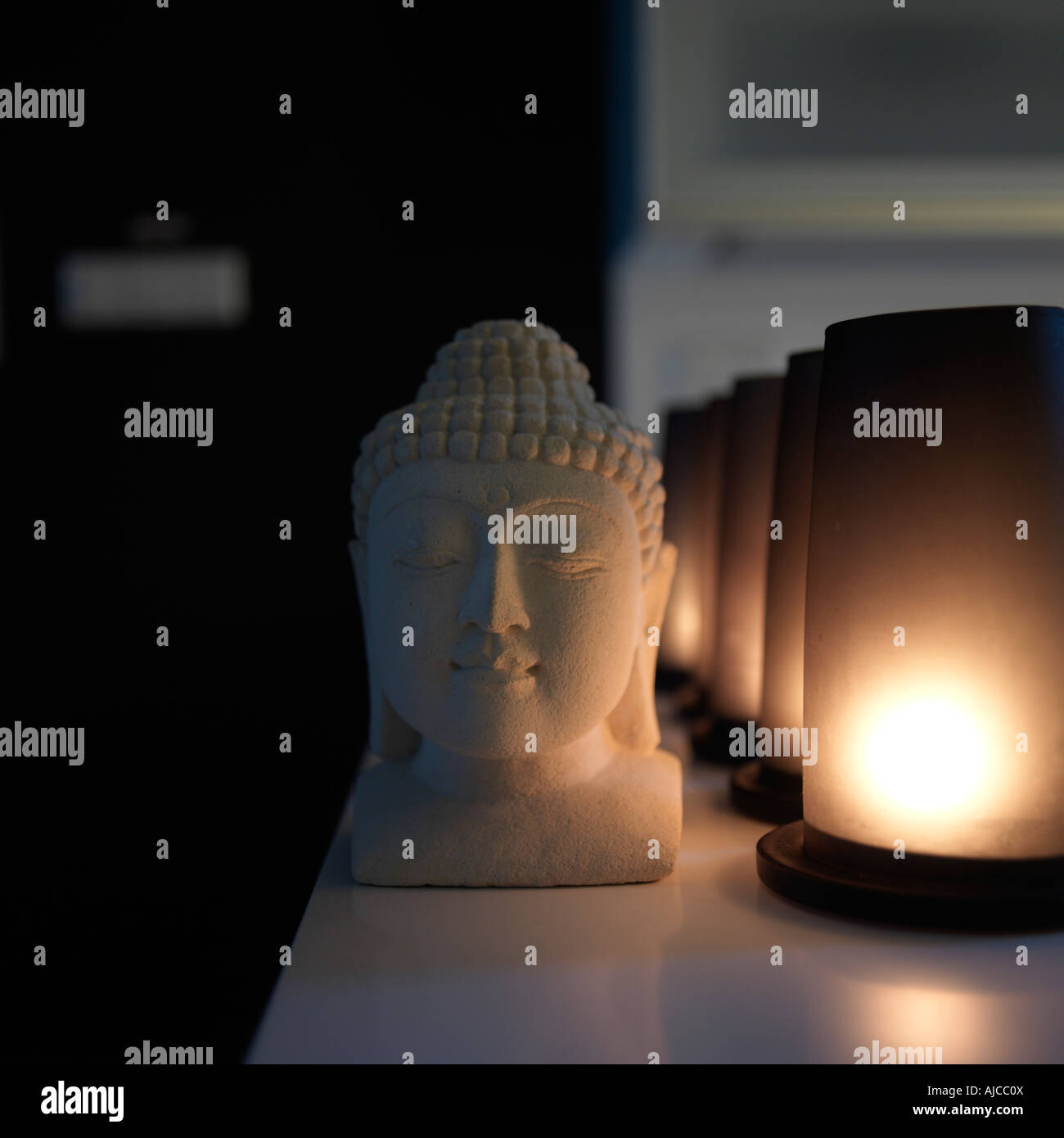 Close-up of Buddha statue and lights - Stock Image
